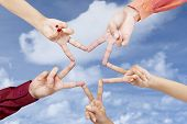 stock photo of v-day  - Victory gesture star shape made from human hands - JPG