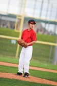 Little League Pitcher In Red Looking.