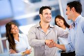 stock photo of handshake  - Handshake of two business men closing a deal at the office - JPG