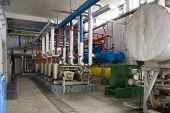 stock photo of dynamo  - Industrial size generators in a factory machinery room - JPG