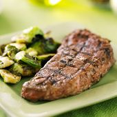 foto of braai  - grilled new york strip steak with brussel sprouts - JPG
