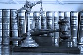 stock photo of justice law  - Symbol of law and justice with books law and justice concept focus on the gavel blue tone - JPG