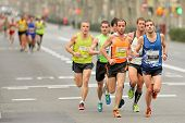 BARCELONA - FEB, 17: Group of runners in Barcelona streets running during Barcelona Half Marathon in