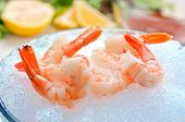 picture of tiger prawn  - A group of tiger shrimp on a bowl of ice with lemons - JPG