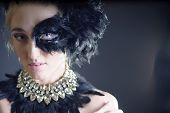stock photo of half naked  - portrait of sexy woman with black feather half mask for Venice desire concept - JPG