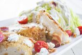 stock photo of iceberg lettuce  - Salad of iceberg lettuce wedge with breaded chicken - JPG