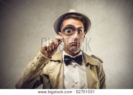 investigator looking with magnifying glass