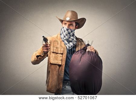 bandit with gun and big sack of money
