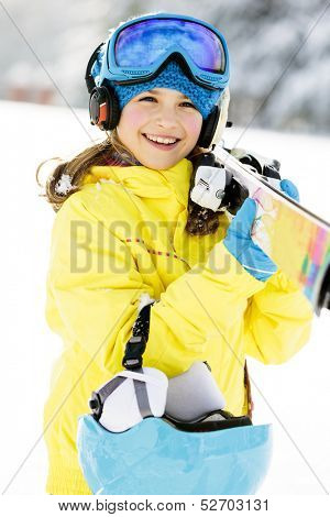 Skiing, skier, winter sports - portrait of happy young skier