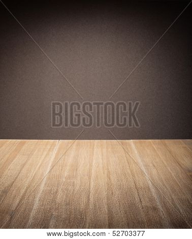 Wooden table in front of wall