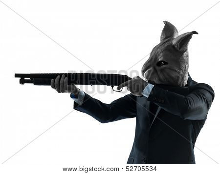 one caucasian man rabbit mask hunting with shotgun portrait in silhouette studio isolated on white background