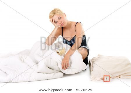 Tired Woman In Bed