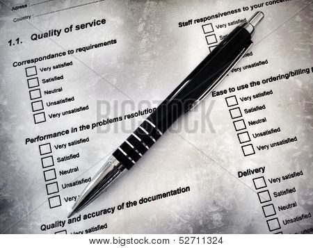 Pen laying on a customer satisfaction form
