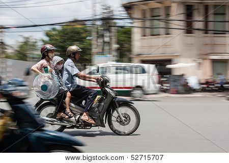 Family On Motorcycle With Fan - Ho Chi Minh City