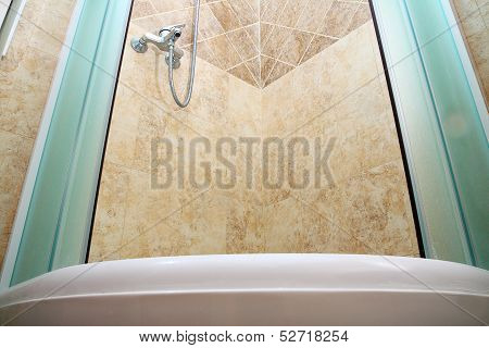 Expensive shower cabin with glass curtain