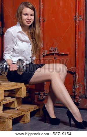 young business woman hold the free weights