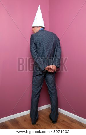 Businessman Standing In The Corner
