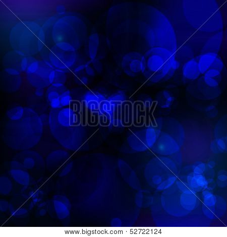 Glittering Blurry Blue Lights Against A Black Background