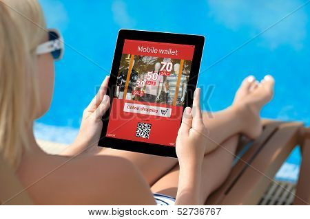 Girl Lying On A Sun Lounger By The Pool With A Tablet And Onlain Shopping On The Screen