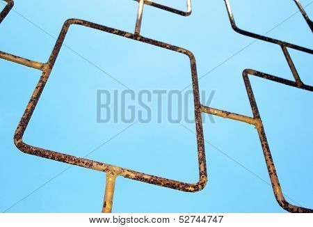 Angled Abstract Closeup View Of Metal Gate On Sky