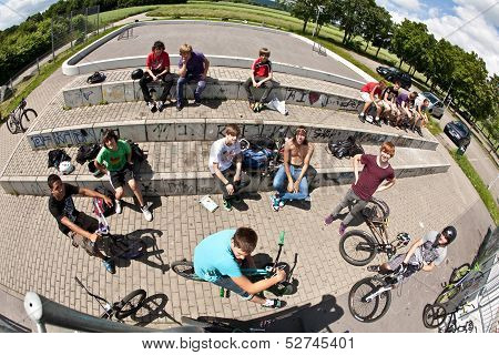 Boys At A Skate Park Watching Other Bikers And Having Fun