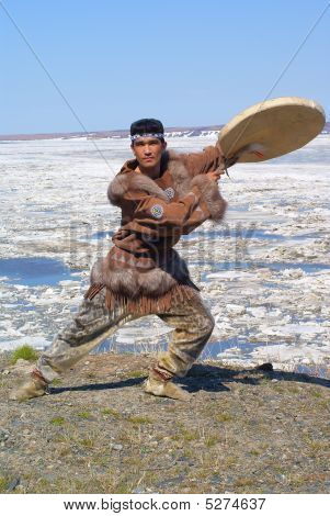 Chukchi mah in folk dress is in folk dance position