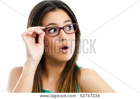 Cute Teen Girl With Glasses Looking Aside.