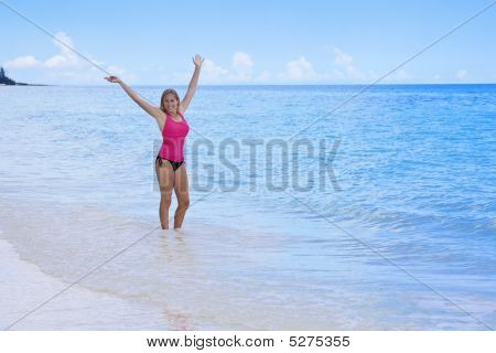 Happy, Healthy Woman At The Beach
