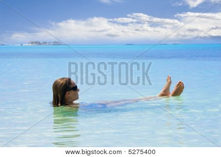 Woman Relaxing In The Ocean