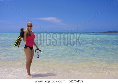 Woman Snorkeling In The Ocean