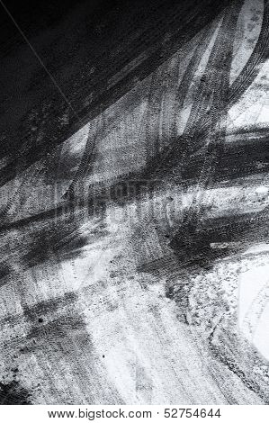 Abstract Background Texture Of Asphalt Road Covered With Snow And Tire Tracks