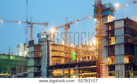 Big Construction Site Cranes at dusk