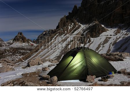 Illuminated green alpine tent  - moonlight