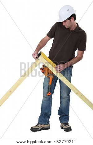 Worker using a right angle ruler to measure an angle