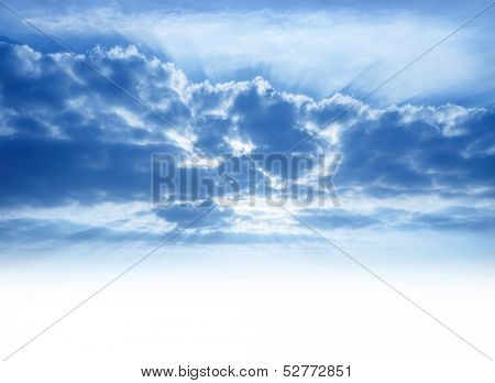 Bright sunrays make their way through cumulonimbus clouds, sky background with copy space, beautiful heaven, atmosphere concept