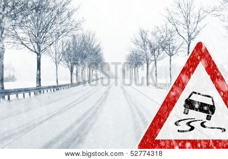 Snowy road with traffic sign
