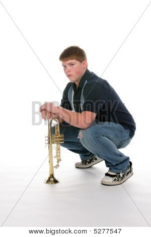 Teenage Boy Leaning On His Upright Trumpet