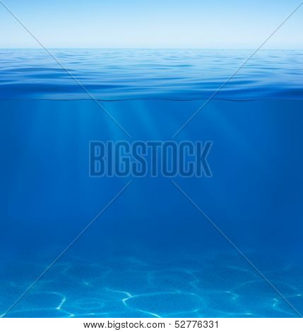 sea or ocean water surface with underwater split by waterline