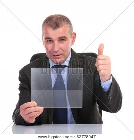 business man at the desk, holding a transparent pannel and showing thumb up to the camera. on a white background