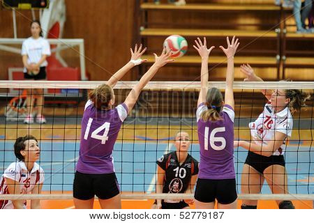 KAPOSVAR, HUNGARY - SEPTEMBER 20: Rebeka Rak (white 16) in action at the Hungarian I. League volleyball game Kaposvar (white) vs Ujpest (purple), September 20, 2013 in Kaposvar, Hungary.