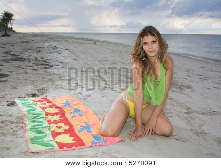 Pretty Girl Standing On Her Knees In The Beach