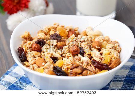 Healthy muesli breakfast with huts and raisin