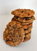 foto of baked raisin cookies  - Stack of Fresh Homemade oatmeal cranberry raisin cookies with sugar dusting - JPG