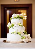 stock photo of marriage ceremony  - Beautiful and tasty wedding cake at wedding reception - JPG