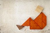 stock photo of tangram  - abstract sitting or relaxing figure built from seven tangram wooden pieces - JPG