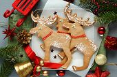 Homemade Christmas Elk-shaped Cookies With Christmas Decoration.
