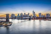 picture of world-famous  - Famous view of New York City over the East River towards the financial district in the borough of Manhattan - JPG