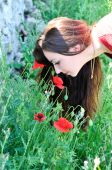Beautiful Brunette Smelling Poppies