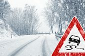 stock photo of slippery-roads  - Sudden and heavy snowfall on a country road - JPG