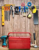 stock photo of carpentry  - Carpentry tools hanging on the wall - JPG